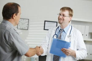doctor shaking hands with patient - n